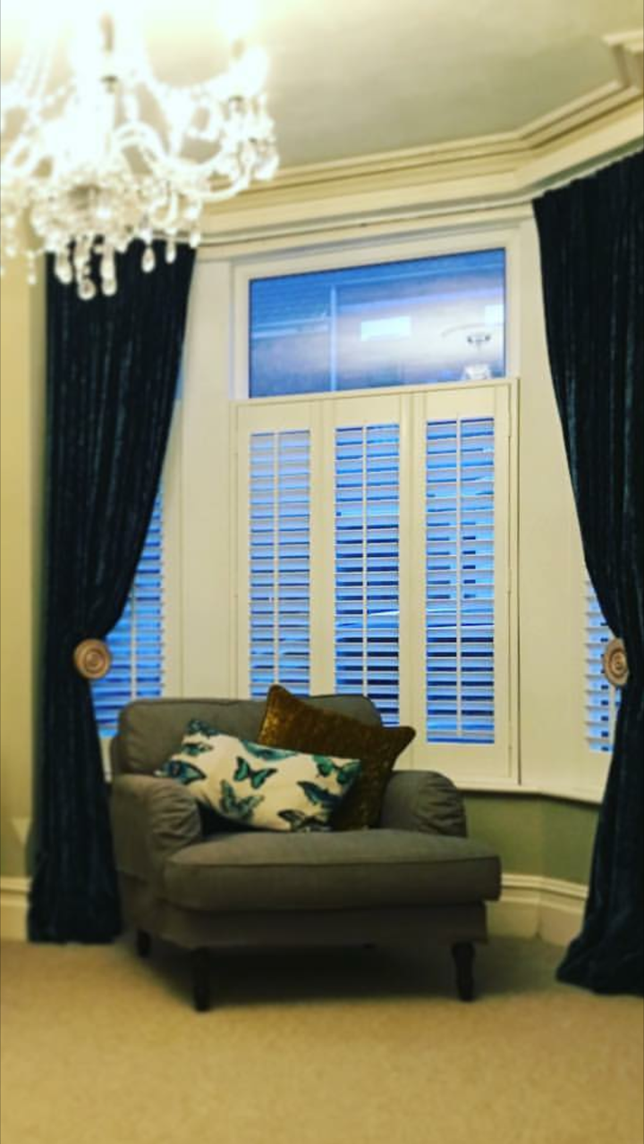 Cafe style shutters in a bay - Curtains by Design