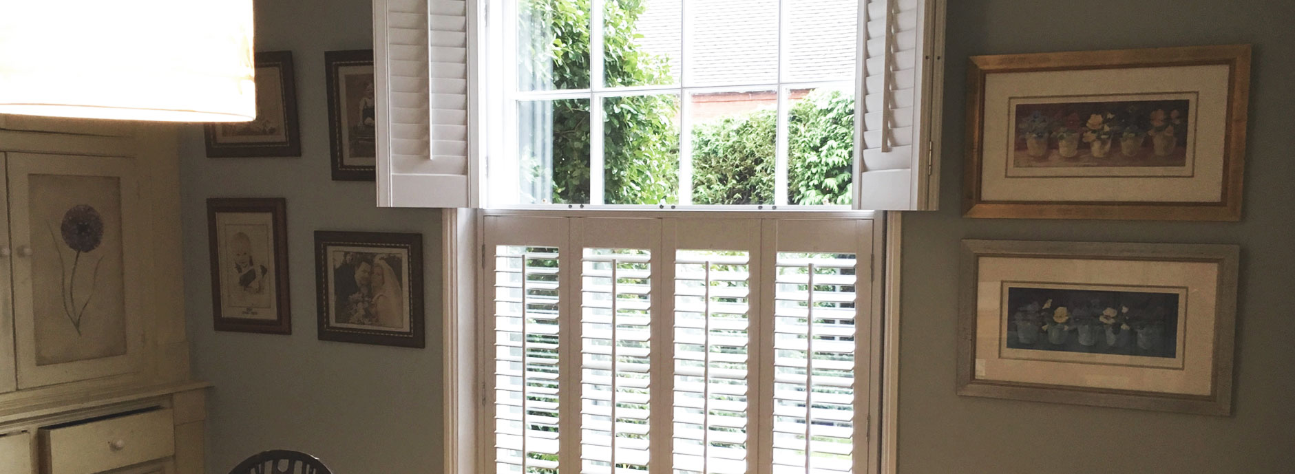 Faux wood tier on tier shutters - Curtains by Design