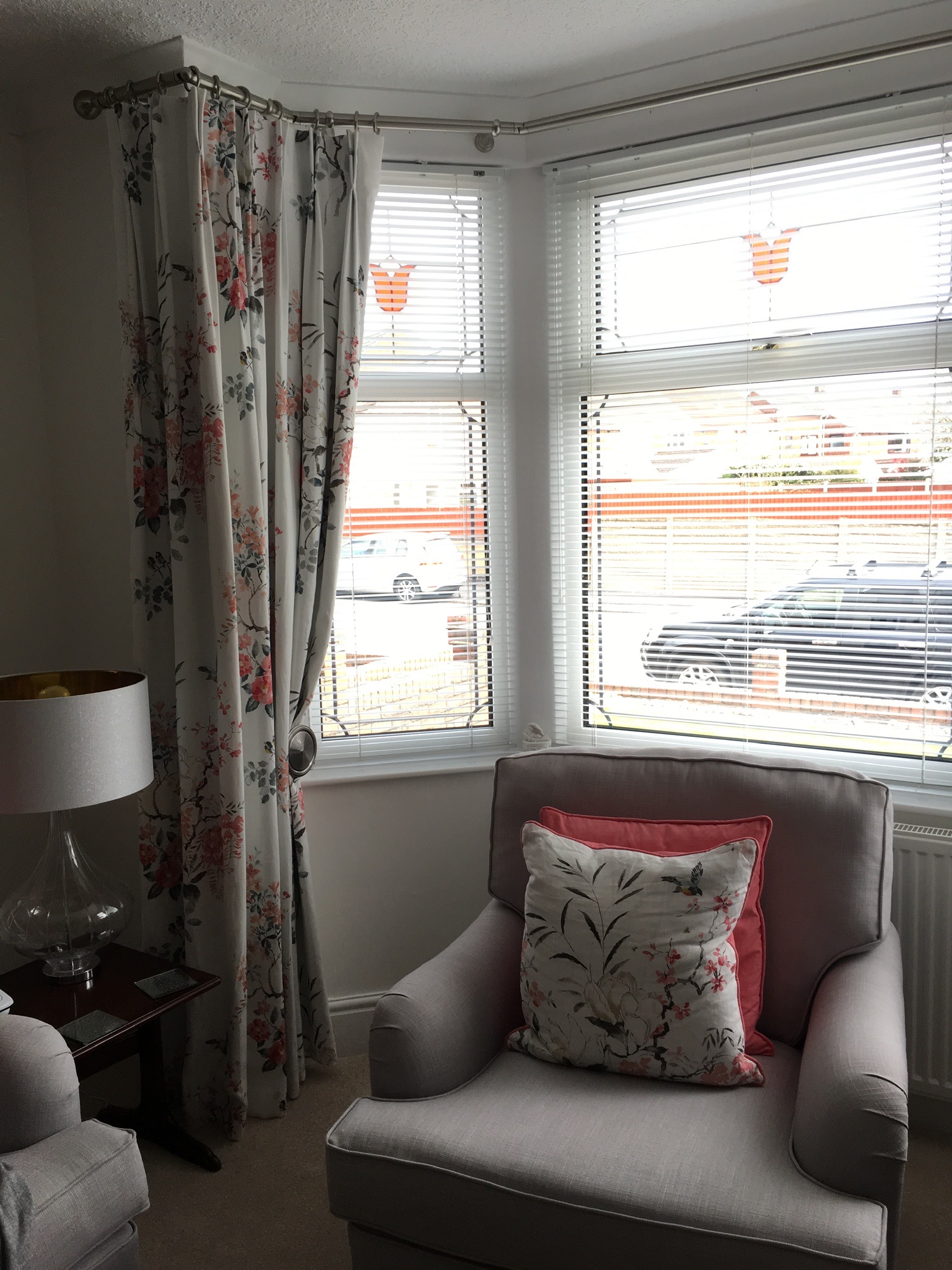 Double pinch pleat curtains in a bay window