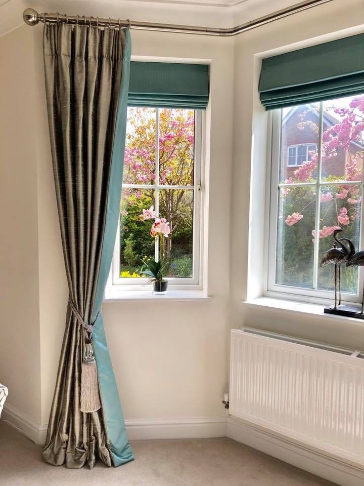 Silk dress curtains in a bay window